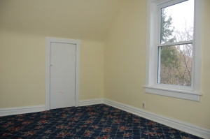 The flooring in the back bedroom when we moved in.