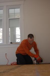 Adam trimming the edge of the subfloor.