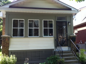 image of the outside of a house with a fully enclosed porch.