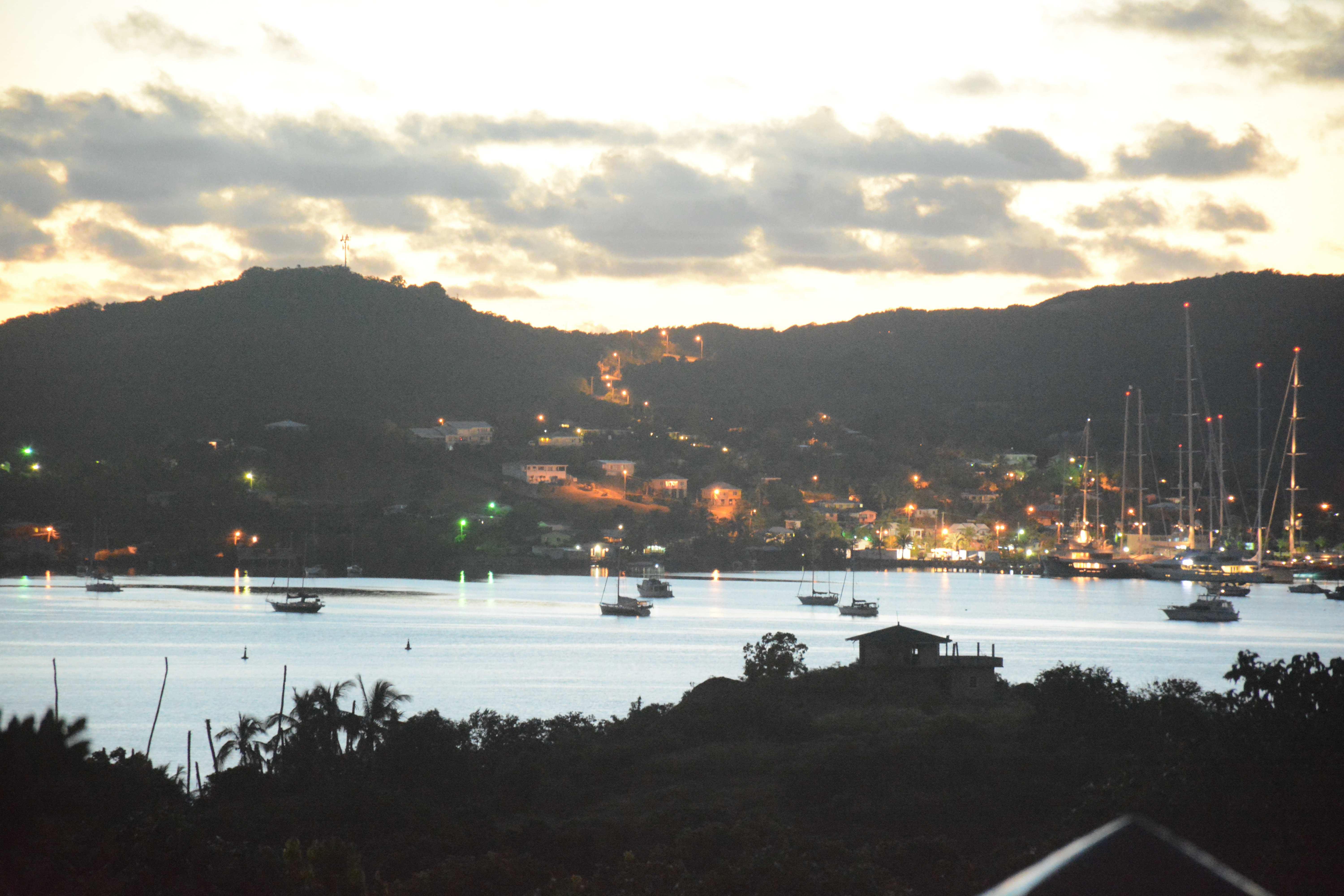 View of harbour at night with lights.